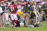 Aug. 28, 2009; Glendale, AZ, USA; Team doctors and trainers tend to Green Bay Packers wide receiver Greg Jennings after being hit against the Arizona Cardinals during a preseason game at University of Phoenix Stadium. Mandatory Credit: Mark J. Rebilas-