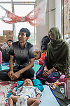 28 August 2019, Jakarta, Indonesia: - Afghan baby Mehran, just 40 days old, with her mother, Khadija Hussani (31), father Yassin Husssani  inside their shared room at the UNHCR refugee centre in Kalideres, Jakarta. Plans to re-locate the overcrowded refugees have been fast tracked after a fight broke out between the groups, many of whom have been in Indonesia for years waiting for placement. Tensions ran high between Afghan and African groups in the centre with a lack of adequate food for the refugees being the catalyst. The African groups, who were moved onto the footpath, were being bussed out today. Conditions in the centre are grim and the local Indonesian population not happy with the refugees presence in the suburb.Picture by Graham Crouch/The Australian