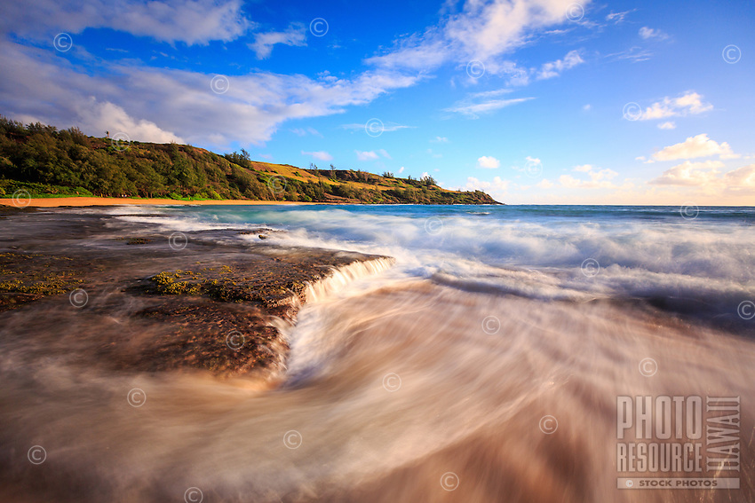 Ocean water rushes off the reef at Moloa'a Bay, Northeast Kaua'i.