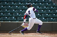 Yeyson Yrizarri (2) of the Winston-Salem Rayados follows through on his swing against the Potomac Nationals at BB&T Ballpark on August 12, 2018 in Winston-Salem, North Carolina. The Rayados defeated the Nationals 6-3. (Brian Westerholt/Four Seam Images)