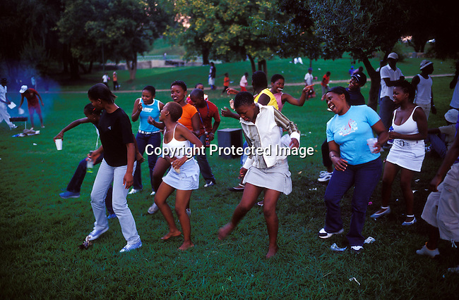 Youth,girls,party,park,middle-class,black,dancing.Youth enjoys a birthday party on the lawn at Thokoza Park in Soweto, South Africa..©Per-Anders Pettersson/iAfrika Photos