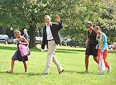 Washington, D.C. - September 6, 2009 -- United States President Barack Obama waves as he and his family return to the White House aboard Marine 1 after spending the past few days as Camp David on Sunday, September 6, 2009. From left to right: Sasha Obama, President Obama, first lady Michelle Obama, and Malia Obama..Credit: Ron Sachs / Pool via CNP