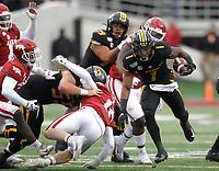 Arkansas Democrat-Gazette/THOMAS METTHE -- 11/29/2019 --<br /> Missouri running back Tyler Badie (1) runs through Arkansas defenders during the third quarter of the Razorbacks' 24-14 loss to Missouri on Friday, Nov. 29, 2019, at War Memorial Stadium in Little Rock.