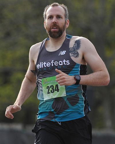 Joe Meyer, 33, of Central Islip runs to a second place finish in the inaugural 1-mile race as part of Long Island Marathon Weekend at Eisenhower Park on Saturday, May 5, 2018.