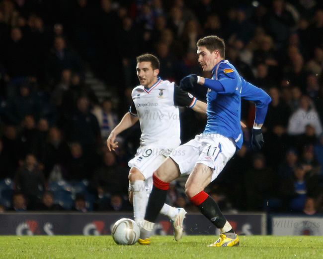 Kyle Lafferty nips in to score the winning goal for Rangers