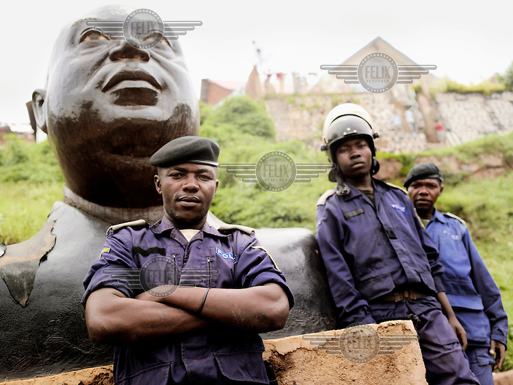 Policemen posing in front of a bust of Laurent-Desire Kabila, former president of the Democratic Republic of Congo, who was killed by his own bodyguards. Shortly after, in January 2001, the office was taken over by his son Joseph Kabila, born in 1971, who has been president ever since. D.R.Congo's national police are known for the massive spread of corruption and sexual assault on the country's women.