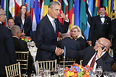 United States President Barack Obama (L) jokes with South African President Jacob Zuma, who was talking on the phone, during a luncheon hosted by United Nations Secretary-General Ban Ki-moon at the 70th annual UN General Assembly at the UN headquarters September 28, 2015 in New York City. Obama held a bilateral meeting with Indian Prime Minister Narendra Modi and will have a face-to-face meeting with Russian President Vladimir Putin later in the day.<br /> Credit: Chip Somodevilla / Pool via CNP