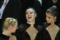 Nathalie Fauquette of France smiles with French rhythmic group and solo portrait before competition at 2006 Thiais Grand Prix in Paris, France on March 25, 2006.  (Photo by Tom Theobald)