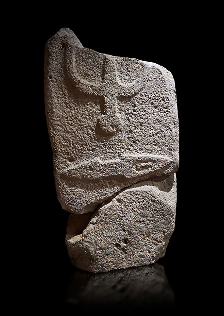 Central fragment of a Late European Neolithic prehistoric Menhir standing stone with carvings on its face side. The representation of a stylalised male figure would have started at the top with the remaons of  a carving of a falling figure with head at the bottom and 2 curved arms encircling a body above. at the bottom is a carving of a dagger running horizontally across the menhir.  Excavated from Piscina 'E Sali VI site,  Laconi. Menhir Museum, Museo della Statuaria Prehistorica in Sardegna, Museum of Prehoistoric Sardinian Statues, Palazzo Aymerich, Laconi, Sardinia, Italy. Black background.