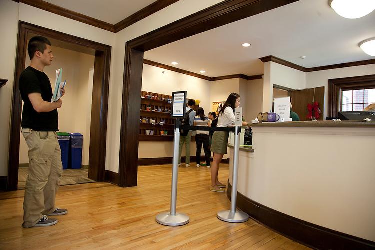 Lei Han waits while Lulu talks to an advisor in the Walter International Education Center.