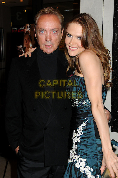 "UDO KIER & DOMINIQUE SWAIN.""Fall Down Dead"" Los Angeles Premiere held at Laemmle's Music Hall,  Beverly Hills, California, USA, .18th December 2009..half length dress strapless green smiling arm around shoulder black suit jacket gold clutch bag .CAP/ADM/BP.©Byron Purvis/Admedia/Capital Pictures"