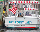 United States President Barack Obama and daughter Sasha Obama board the Bay Point Lady on their way to take a boat ride in St. Andrews Bay, Sunday, August 15, 2010 In Panama City Beach, Florida. The First Family is visiting the area to help promote tourism and check up on cleanup efforts from the aftermath of the Deepwater Horizon Oil spill..Credit: Mark Wallheiser - Pool via CNP
