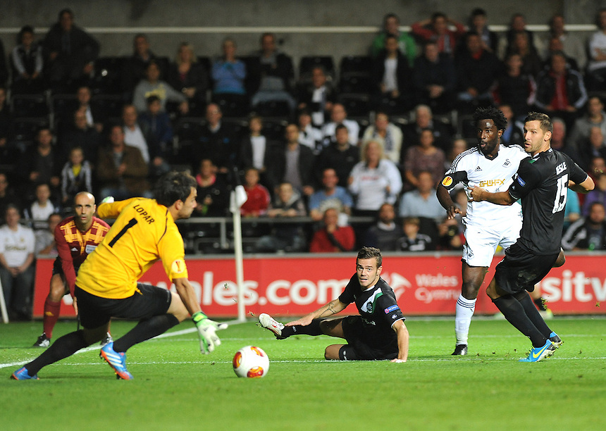 Swansea City's Wilfried Bony has a shot on goal<br /> <br /> Photo by Ashley Crowden/CameraSport<br /> <br /> Football - Europa League Group A - Swansea City v St Gallen - Thursday 3rd October 2013 - The Liberty Stadium - Swansea<br /> <br /> &copy; CameraSport - 43 Linden Ave. Countesthorpe. Leicester. England. LE8 5PG - Tel: +44 (0) 116 277 4147 - admin@camerasport.com - www.camerasport.com