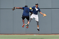 Damiere Byrd of the Carolina Panthers, right, smiles and chest bumps former South Carolina football player Marcus Lattimore after making a spectacular catch in the Celebrities vs. Soldiers Softball Game as part of the South Atlantic League All-Star Game festivities on Monday, June 19, 2017, at Spirit Communications Park in Columbia, South Carolina. (Tom Priddy/Four Seam Images)