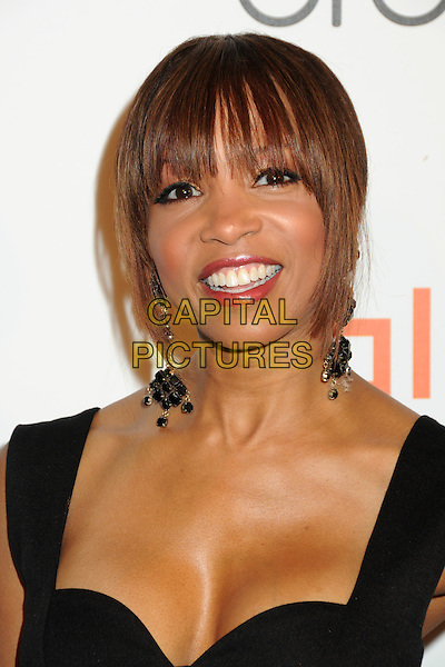 "ELISE NEAL .Interscope Geffen A&M Records 4th Annual ""Creme of the Crop"" Post BET Awards 2010 Celebration held at Mr. Chow Restaurant,  Beverly Hills, California, USA, 27th June 2010..portrait headshot fringe smiling black dangly earrings .CAP/ADM/BP.©Byron Purvis/AdMedia/Capital Pictures."