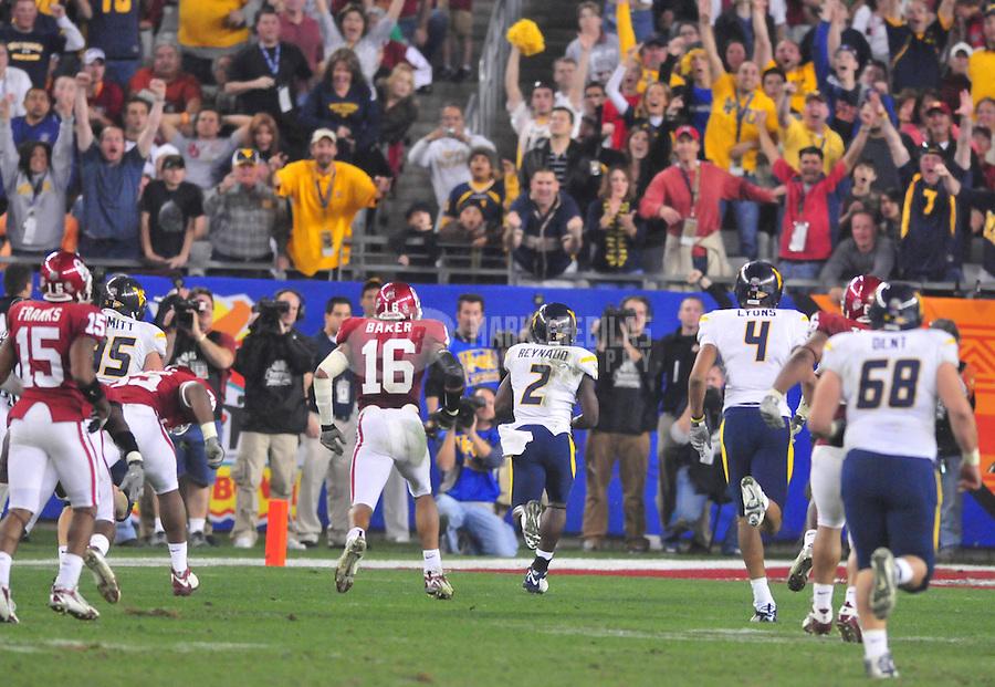 Jan 2, 2008; Glendale, AZ, USA; West Virginia Mountaineers wide receiver Darius Reynaud (2) runs for a third quarter touchdown against the Oklahoma Sooners during the Fiesta Bowl at University of Phoenix Stadium. West Virginia defeated Oklahoma 48-28. Mandatory Credit: Mark J. Rebilas-US PRESSWIRE