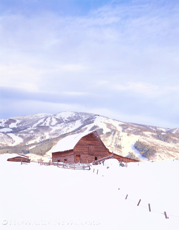 Old barn in Winter near Steamboat Springs ski area, Colorado.