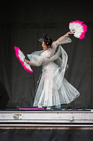 Beautiful Chinese Woman Performing Fan Dance at the Lunar New Year Celebration, Chinatown, Seattle, WA, USA.
