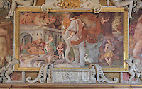 The Royal Elephant decorated with fleur de lys, representing the King, fresco by Rosso Fiorentino, 1535-37, in a carved stucco frame, in the Galerie Francois I, begun 1528, the first great gallery in France and the origination of the Renaissance style in France, Chateau de Fontainebleau, France. The Palace of Fontainebleau is one of the largest French royal palaces and was begun in the early 16th century for Francois I. It was listed as a UNESCO World Heritage Site in 1981. Picture by Manuel Cohen