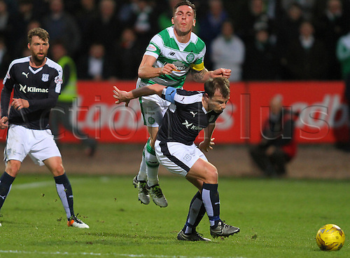 05.04.2016. Dens Park, Dundee, Scotland. Scottish Football Premiership Dundee versus Celtic. Scott Brown is blocked from the ball by Paul McGowan