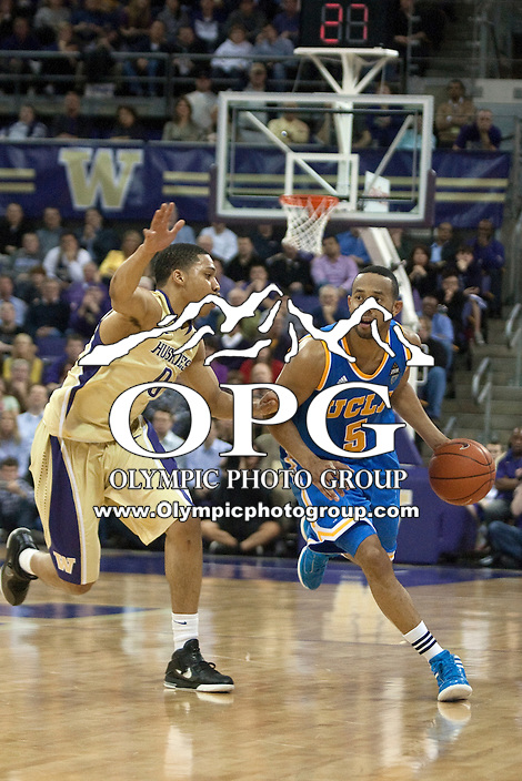 Feb 2, 2012:  Washington's #0 Abdul Gaddy guards UCLA's #5 Jerime Anderson as he brings the ball down court.  Washington defeated UCLA 71-69 at Alaska Airlines Arena Seattle, Washington...