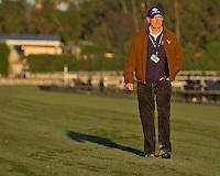 Trainer John Gosden surveys the turf course at Santa Anita Park in Arcadia, California on October 30, 2013.