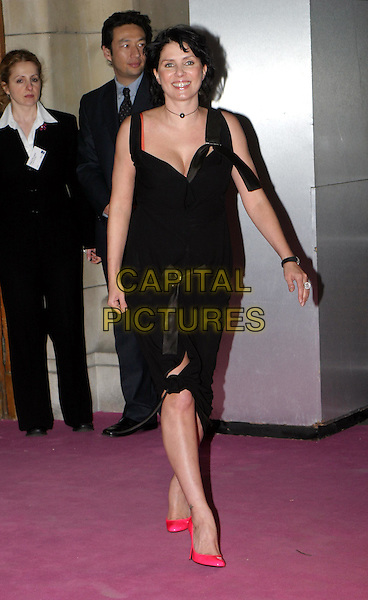 SADIE FROST.Private view to open the V&A's major Westwood exhibition.30 March 2004.full length, full-length, little black dress, bright pink stilettos, heels, shoes.www.capitalpictures.com.sales@capitalpictures.com.© Capital Pictures.