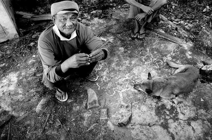 "Mekong Dam Victims - Thailand. Mr. Kan Wangphon (73). For the loss of his house, situated on the present dam site, he got a new house a few kilometres away from the river that was never constructed completely. The distance from the river makes it impossible to cultivate rice and vegetables and to continue fishing. The building of the Pak Mun Dam in Thailand has lead to strong opposition by the local population as the number of fish and fish species in the river is dramatically reduced because of the dam, affecting more than 20,000 people. Known as ""The Mother of Waters"", more than 60 million people depend on the Mekong river and its tributaries for food, fresh water, transport and other aspects of daily life. The construction of big dams is now threatening the life of these people aswell as the vital and unique ecosystem of the river."