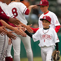 STANFORD, CA - April 22, 2011: Young fans of Stanford baseball shake hands with the team after the throwing out the first pitch before Stanford's game against UCLA at Sunken Diamond. Stanford lost 4-1.