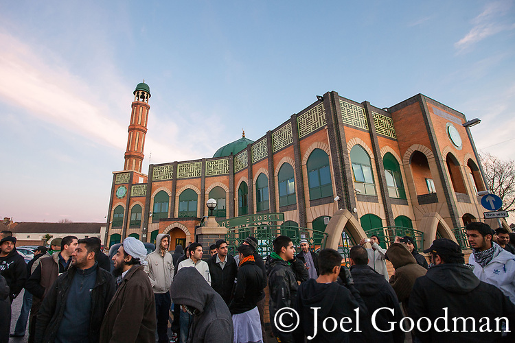 © Joel Goodman - 07973 332324 . 11/12/2010 . Peterborough , UK . People outside a mosque in the town centre . The English Defence League ( EDL ) hold a demonstration in Peterborough . Photo credit : Joel Goodman