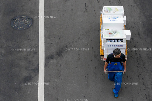 A man carries merchandise at the new Tokyo Metropolitan Central Wholesale Market which opened in Toyosu on October 11, 2018, Tokyo, Japan. The new fish market replaces the famous Tsukiji Fish Market which closed for the last time on Saturday 6th October. The move to Toyosu was delayed for almost 2 years because of fears over toxins found in water below the new market. (Photo by Rodrigo Reyes Marin/AFLO)