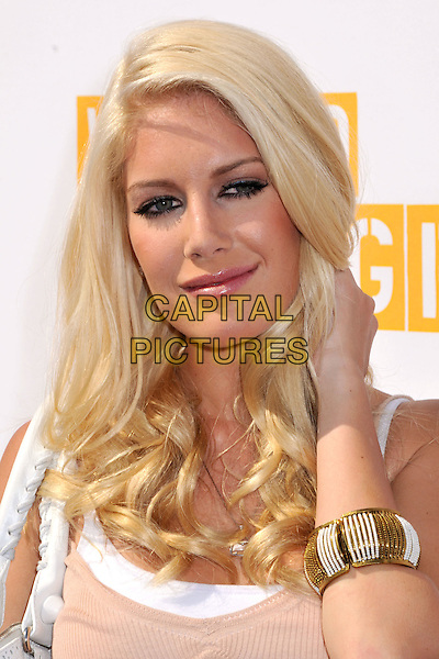 """HEIDI MONTAG.Taco Bell's 2nd Annual """"Reality Check"""" for World Hunger Relief Week at Taco Bell, Los Angeles, California, USA..October 2nd, 2008.headshot portrait hand gold white bracelet .CAP/ADM/BP.©Byron Purvis/AdMedia/Capital Pictures."""