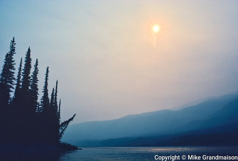 Fire Smoke on the Nahanni River amd the surrounding Mackenzie Mountains, Nahanni National Park, Northwest Territories, Canada