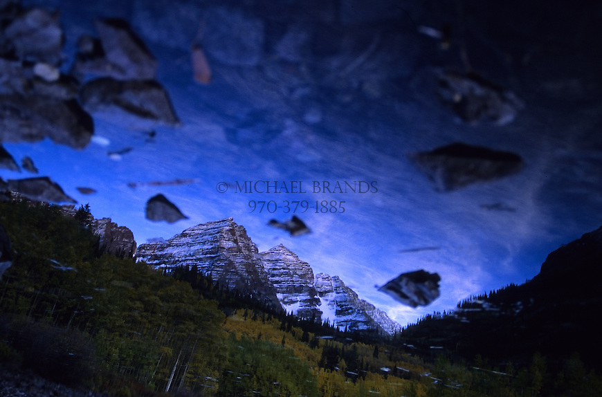 A reflection of the Maroon Bells at sunrise near Aspen, Colorado. The image has been rotated. © Michael Brands.