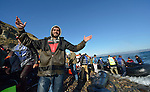 When he landed on the Greek island of Lesbos on November 2, 2015, this refugee man raised his arms in joy. He survived the boat trip from Turkey and faced the continuation of his journey toward western Europe.