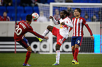 Peguy Luyindula (8) of the New York Red Bulls and Carlos Alvarez (20) of Chivas USA attempt to play the ball. The New York Red Bulls and Chivas USA played to a 1-1 tie during a Major League Soccer (MLS) match at Red Bull Arena in Harrison, NJ, on March 30, 2014.