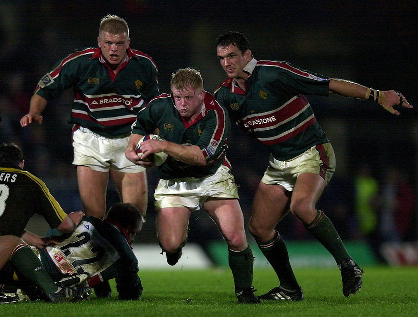 Photo. Richard Lane.London Wasps v Leicester Tigers at Adams Park. Zurich Premiership. 27/12/2002.Dorian West attacks with Adam Balding and Martin Johnson in support.
