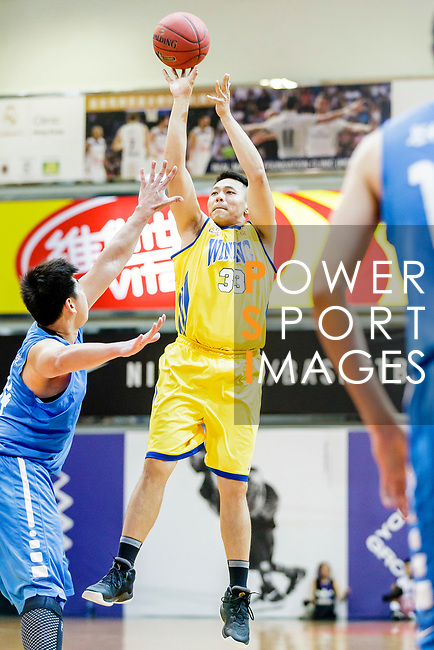 Ching Kin Man #33 of Winling Basketball Club tries to score against the Fukien during the Hong Kong Basketball League game between Winling and Fukien at Southorn Stadium on May 29, 2018 in Hong Kong. Photo by Yu Chun Christopher Wong / Power Sport Images