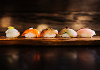 From left to right, nigiri dishes including Masu (Tasmanian Ocean Trout, Tobiuo (Flying Fish), Kinmedai (Golden eye Snapper), Inada (Baby Yellowtail) and Kurudai (Black Bream) at Uchi Restaurant in Denver, Colorado, Monday, March 25, 2019.<br /> <br /> Photo by Matt Nager