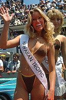 LE MANS, FRANCE - JUNE 17: A Hawaiian Tropic model waves to the crowd from the grid area before the 24 Hours of Le Mans FIA World Sports Car Championship race at the Circuit de la Sarthe in Le Mans, France, on June 17, 1984.