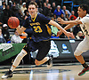 Kevin Voigt #23 of Massapequa, left, looks to get to the net during the Nassau County varsity boys basketball Class AA semifinals against Baldwin at Farmingdale State College on Monday, Feb. 26, 2018. Baldwin won by a score of 50-41.