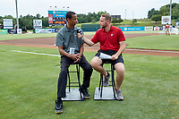 Jonathan Lee (left) of Sox Machine is interviewed by Kannapolis Intimidators broadcaster Trevor Wilt prior to the game against the Greensboro Grasshoppers at Kannapolis Intimidators Stadium on July 9, 2019 in Kannapolis, North Carolina. The Grasshoppers defeated the Intimidators 5-4. (Brian Westerholt/Four Seam Images)