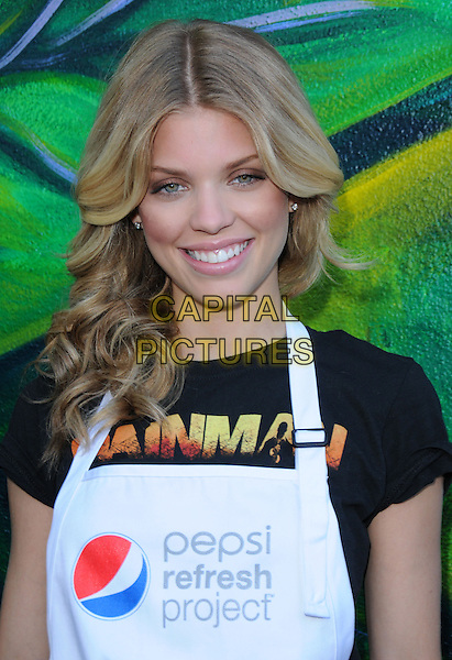 ANNALYNNE McCORD .at the Pepsi Refresh Project Mural Painting at El Salvadore Community Center in Santa Ana, California, USA, July 13th 2010..portrait headshot black t-shirt white apron smiling                                                              .CAP/RKE/DVS.©DVS/RockinExposures/Capital Pictures.