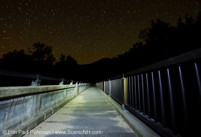 Bridge along the Kancamagus Scenic Byway (Route 112) in Lincoln, New Hampshire during the night.