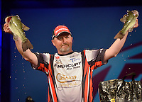 NWA Democrat-Gazette/BEN GOFF -- 04/26/15 Tracy Adams, FLW pro from Wilkesboro, N.C., displays his two best bass during weigh-in on the final day of the Walmart FLW Tour at Beaver Lake at the John Q. Hammons Center in Rogers on Sunday Apr. 26, 2015. Adams finished second with a four-day total of 49 lbs. 12 oz.