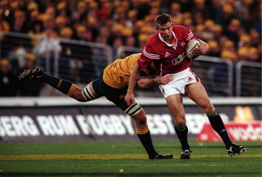 Photo. Richard Lane. .Australia v Bristish and Irish Lions. Lions Tour 2001 to Australia. Third Test at the Stadium Australia, Sydney, Australia. 14/7/2001..Daffyd James is tackled.
