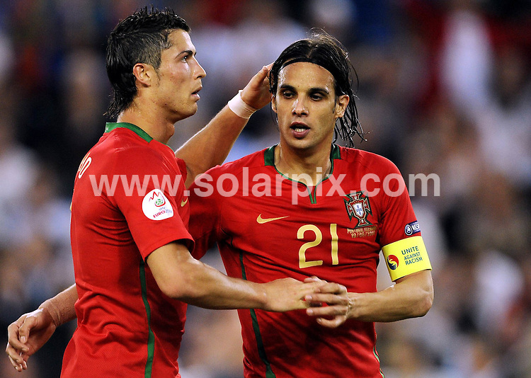 **ALL ROUND PICTURES FROM SOLARPIX.COM**.**SYNDICATION RIGHTS FOR UK AND SPAIN ONLY**.Euro 2008 European Football Championship being held in Austria/Switzerland. Quarter Final, match 25, Portugal vs Germany, at the St. Jakob Park Stadium, Basel, Switzerland. 19th June 2008 ..This pic: Christiano Ronaldo and Nuno Gomes..JOB REF: 6690 CPR/Torsten Silz.DATE: 19_06_2008.**MUST CREDIT SOLARPIX.COM OR DOUBLE FEE WILL BE CHARGED* *UNDER NO CIRCUMSTANCES IS THIS IMAGE TO BE REPRODUCED FOR ANY ONLINE EDITION WITHOUT PRIOR PERMISSION*