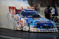 Oct. 31, 2008; Las Vegas, NV, USA: NHRA funny car driver Robert Hight does a burnout during qualifying for the Las Vegas Nationals at The Strip in Las Vegas. Mandatory Credit: Mark J. Rebilas-
