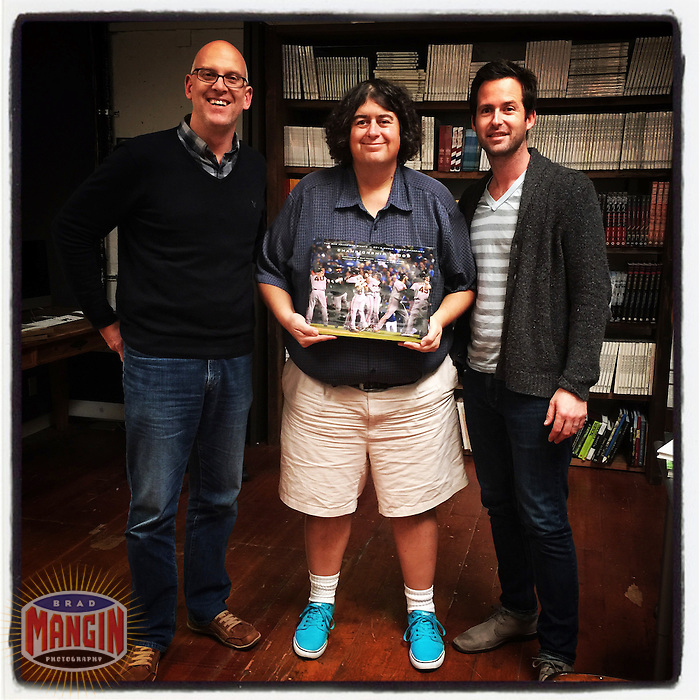 PETALUMA, CA - JANUARY 27: Instagram of authors Brad Mangin with designer Iain Morris and publisher Chris Gruener holding their new book Championship Blood about the 2014 San Francisco Giants on January 27, 2015 at the offices of Cameron + Company in Petaluma, California. Photo by Brad Mangin