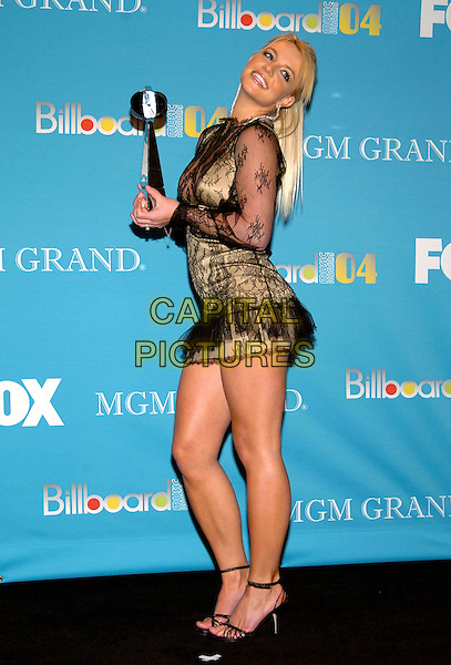 BRITNEY SPEARS.2004 Billboard Music Awards held  at the MGM Grand Garden Arena,  Las Vegas, California, USA, .08 december 2004..full length black sheer lace see trhough thru mini short dress gold award trophy head back.Ref: ADM.www.capitalpictures.com.sales@capitalpictures.com.©V. Summers/AdMedia/Capital Pictures.